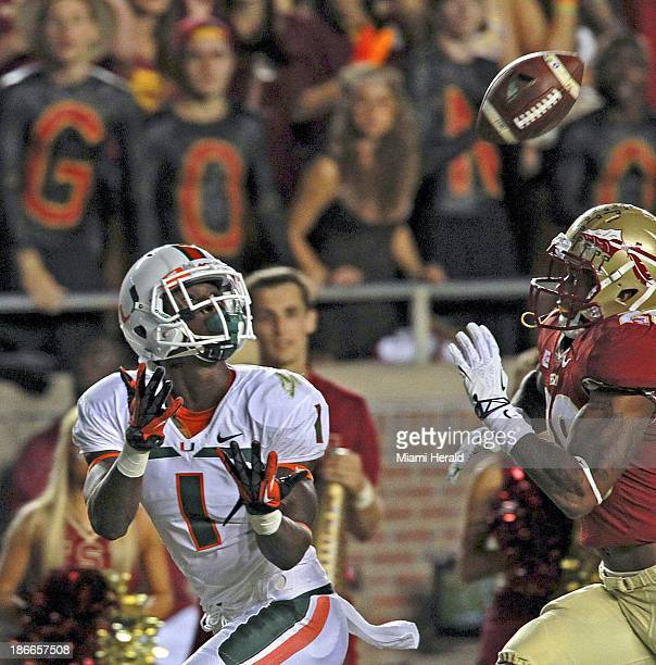 Miami wide receiver Allen Hurns outruns Florida State defensive back PJ Williams for a 33yard touchdown in the first quarter at Doak Campbell Stadium...