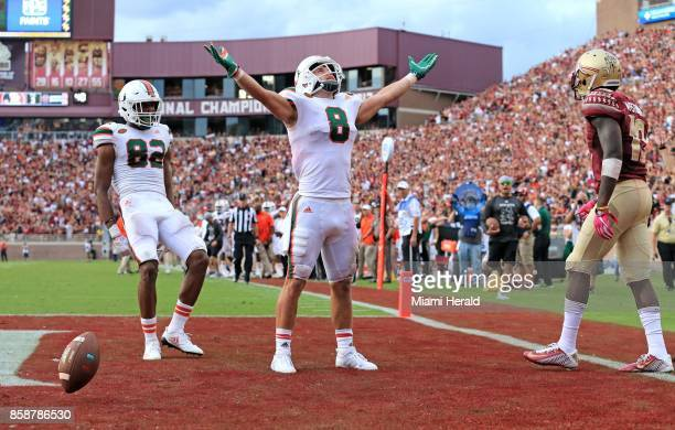 Miami wide receiver Braxton Berrios celebrates his 6yard touchdown reception in the third quarter against Florida State at Doak Campbell Stadium in...