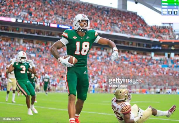 Miami wide receiver Lawrence Cager celebrates a 3yard touchdown reception over Florida State defensive back Asante Samuel Jr in the third quarter at...