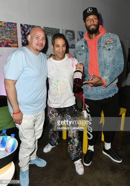 Miamibased Hip hop artist Fat Joe Streetartistturnedartworld phenomenon JonOne and Miami Heat basketball player James Johnson attend Hennessy VS...