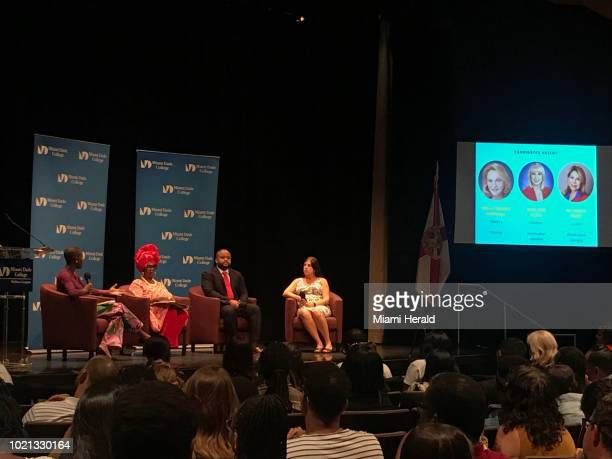 MiamiDade County School Board candidates from left Irene TorroellaGarcia Dorothy BendrossMindingall and Brandon Alfred speak at a candidate forum...