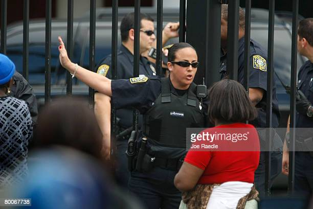 MiamiDade County school police officer tells a parent where to pick up her kids at Miami Edison Senior High School after a melee broke out in the...