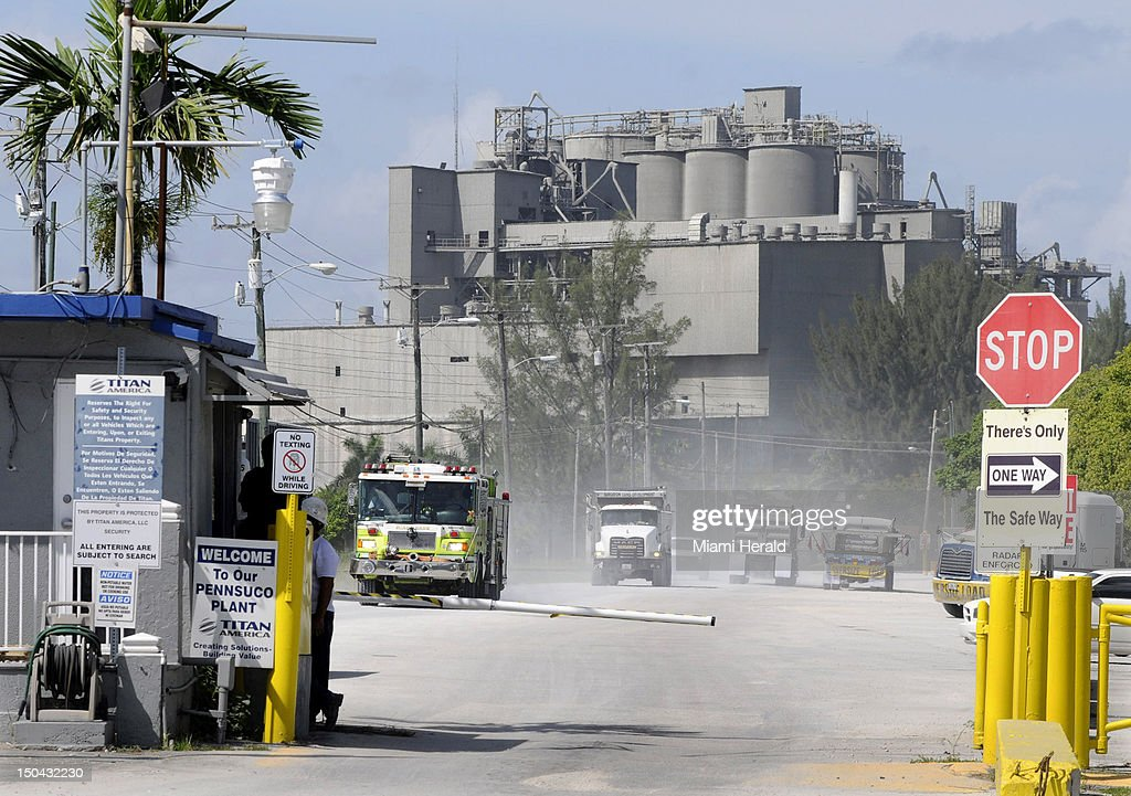 A Miami-Dade Fire Engine leaves the Titan America Cement plant in Medley, Florida, where a roof collapse sent buried a worker on Friday, August 17, 2012.