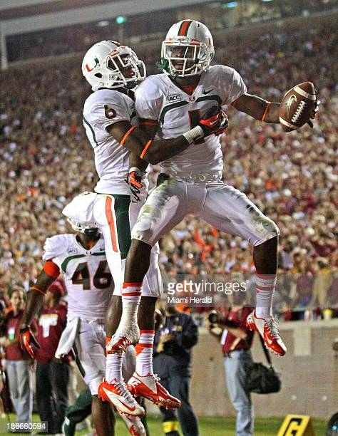 Miami's Allen Hurns celebrates in the end zone with Herb Waters after his 33yard touchdown catch against Florida State at Doak Campbell Stadium in...