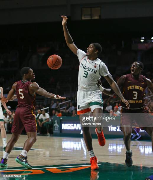 Miami's Anthony Lawrence II middle loses the ball against BethuneCookman's Leon Redd and during the first half at the Watsco Center in Coral Gables...