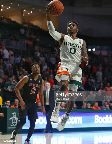 Miami's Chris Lykes goes to the basket against North Carolina State's Torin Dorn during the second half at the Watsco Center in Coral Gables Fla on...