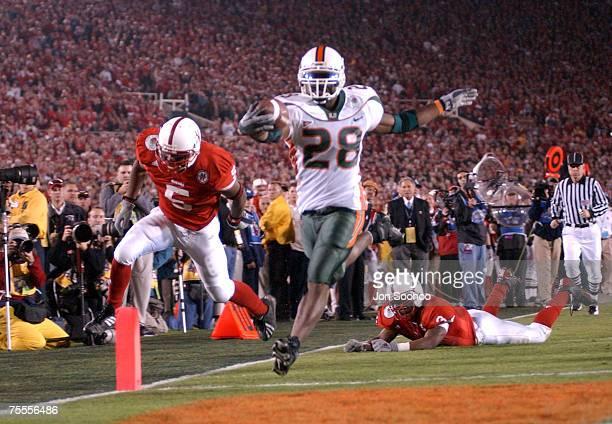 Miami's Clinton Portis scores on a 39 yard run s in the second quarter against Nebraska in the Rose Bowl in Pasadena, California. Miami beat Nebraska...