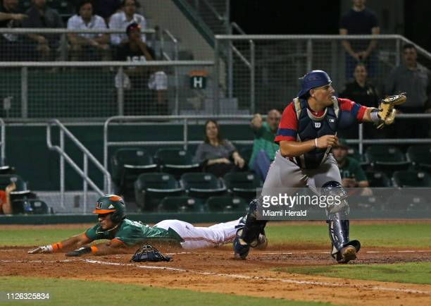 Miami's Freddy Zamora scores on a tworun double by teammate Adrian Del Castillo during the third inning against Florida Atlantic at Alex Rodriguez...