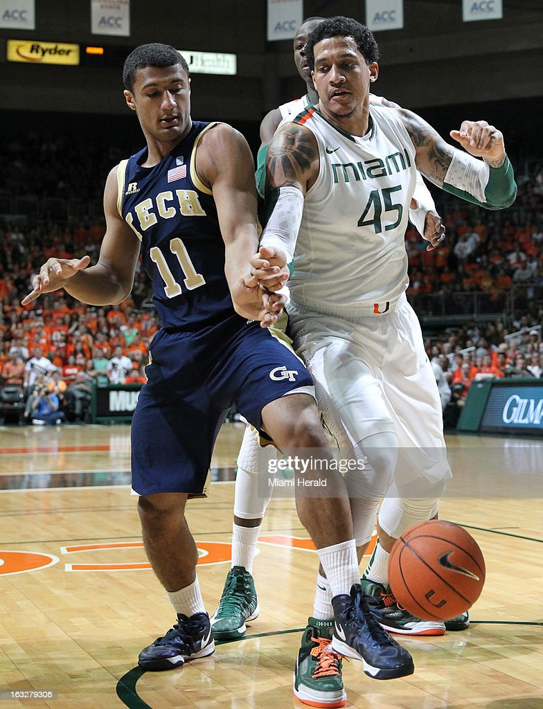 Miami's Julian Gamble and Georgia Tech's Chris Bolden battle for a rebound in the first half at BankUnited Center in Coral Gables, Florida, on Wednesday, March 6, 2013.