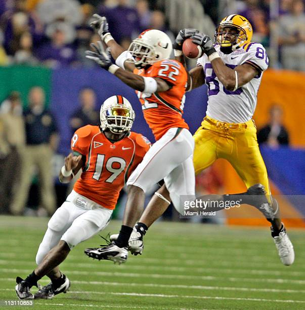 Miami's Kelly Jennings fails to pick off a 32 yard pass reception to LSU's Dwayne Bowe right during the ChickfilA Peach Bowl at the Georgia Dome in...