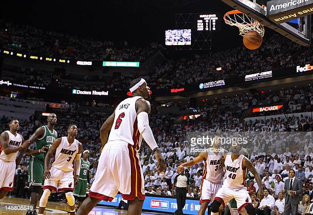 Miami's LeBron James has a good view as the second of two clutch free throws sunk by the Celtics Kevin Garnett second from left drops through the net...