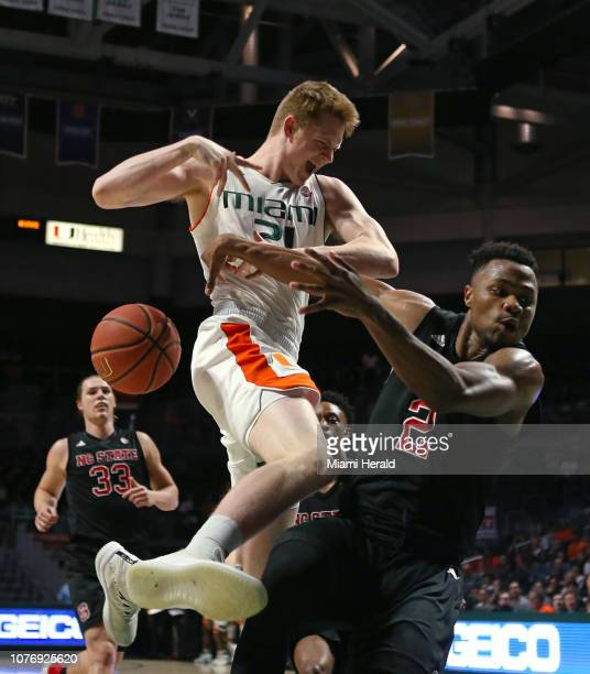 Miami's Sam Waardenburg loses control of the ball against North Carolina State's Torin Dorn during the first half at the Watsco Center in Coral...