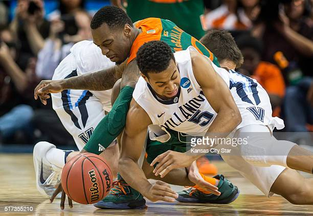 Miami's Sheldon McClellan and Villanova's Phil Booth scramble for a loose ball in the second half during a Sweet 16 matchup in the NCAA Tournament's...