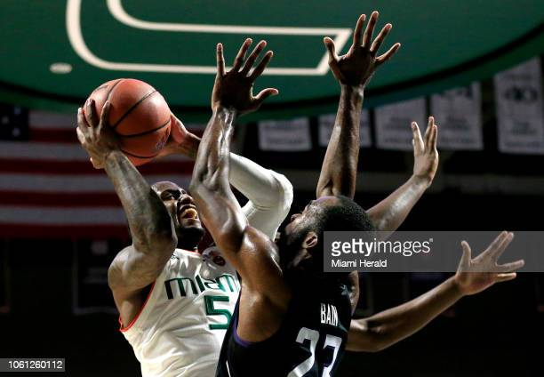 Miami's Zach Johnson battles against Stephen F Austin's Nathan Bain in the first half at Watsco Center in Coral Gables Fla on Tuesday Nov 13 2018 The...