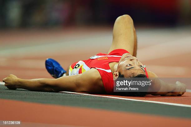 Mian Che of China falls down after competing in the Men's 400m ¿ T36 final on day 6 of the London 2012 Paralympic Games at Olympic Stadium on...