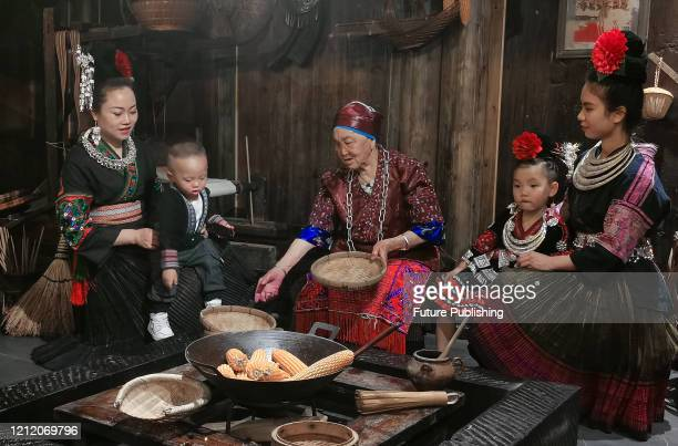 Miao family is eating in Guizhou Xijiang chuanshuo food and beverage Museum, Guiyang City, Guizhou Province, China, May 5, 2020. With a total area of...