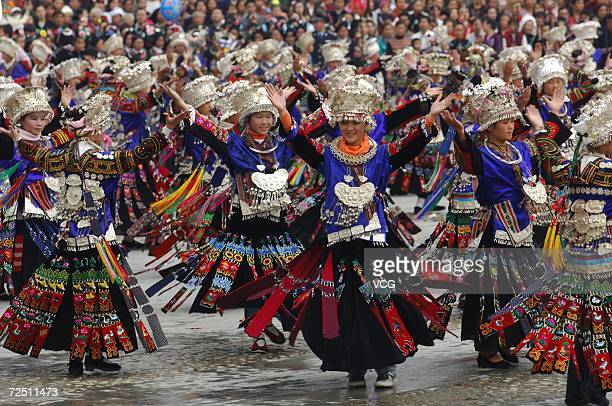 Miao girls wear traditional ethnic costumes as they attend a New Year parade in Leishan on November 10 Leishan, China. As the most important festival...