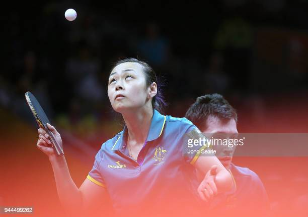 Miao Miao and David Powell of Australia compete against Mo Zhang and Zhen Wang of Canada in the Mixed Doubles Round of 32 during Table Tennis on day...