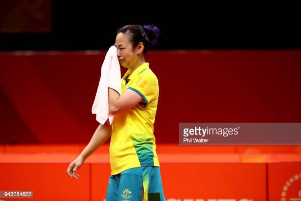 Miao Miao of Australia crys after recieving a time wasting penalty in their Womens Team bronze medal match against Tin-Tin Ho of England during Table...