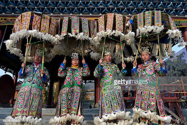 Miao nationality women wearing traditional dress perform during the Sama Festival on December 18 2013 in Rongjiang China The Sama Festival one of...