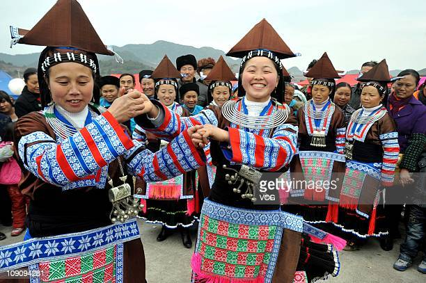 Miao people dance during the folk Miao Nationality Jump Flower Festival at Qing town on February 14 2011 in Guiyang Guizhou province of China Jump...