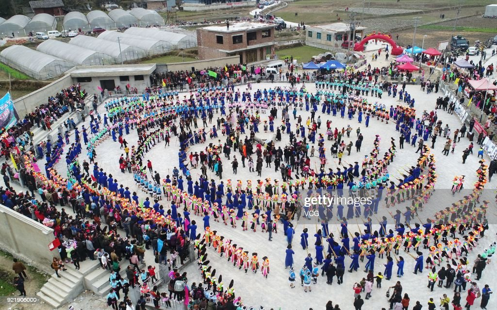 Miao people dance to the rhythm of music to worship ancestors and pray for good weather on the fifth day of the Lunar New Year on February 20, 2018 in Qiannan Buyei and Miao Autonomous Prefecture, Guizhou Province of China.