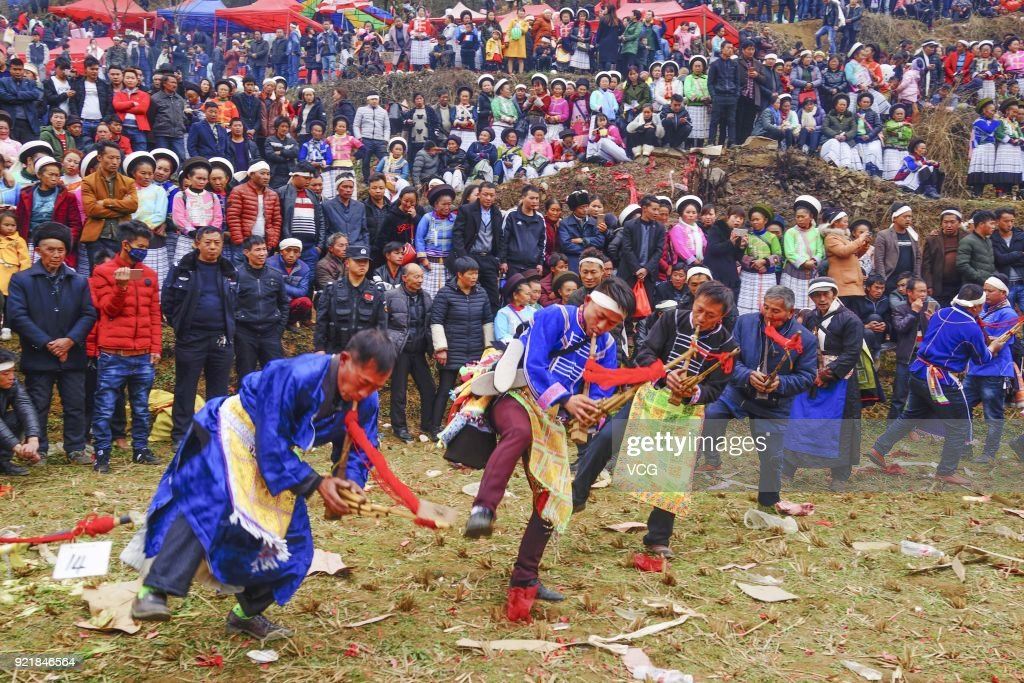 Miao people play Lusheng during the worshipping ceremony of ancestors on the fifth day of the Lunar New Year on February 20, 2018 in Guiyang, Guizhou Province of China. Thousands of Miao people gathered together on the fifth day of the Lunar New Year to worship ancestors and celebrate New Year.