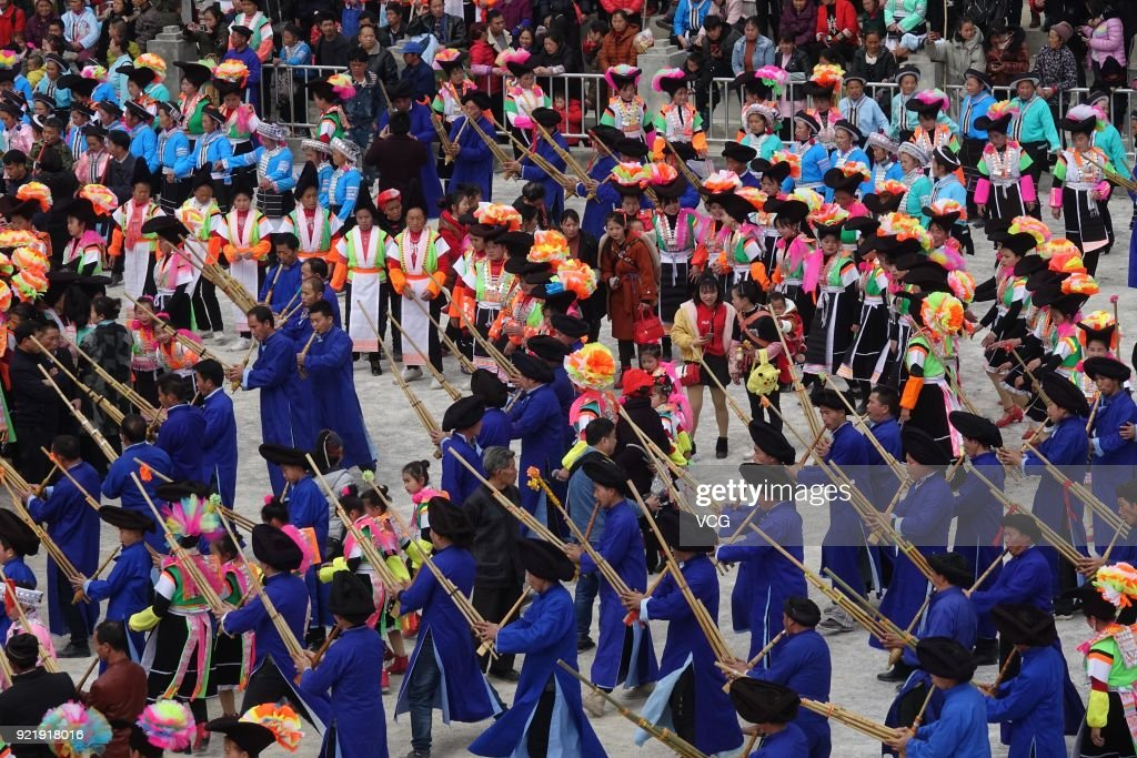 Miao people play Lusheng to worship ancestors and pray for good weather on the fifth day of the Lunar New Year on February 20, 2018 in Qiannan Buyei and Miao Autonomous Prefecture, Guizhou Province of China.
