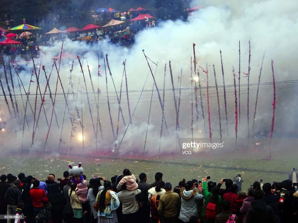 Miao people set off firecrackers during the worshipping ceremony of ancestors on the fifth day of the Lunar New Year on February 20, 2018 in Guiyang, Guizhou Province of China. Thousands of Miao people gathered together on the fifth day of the Lunar New Year to worship ancestors and celebrate New Year.