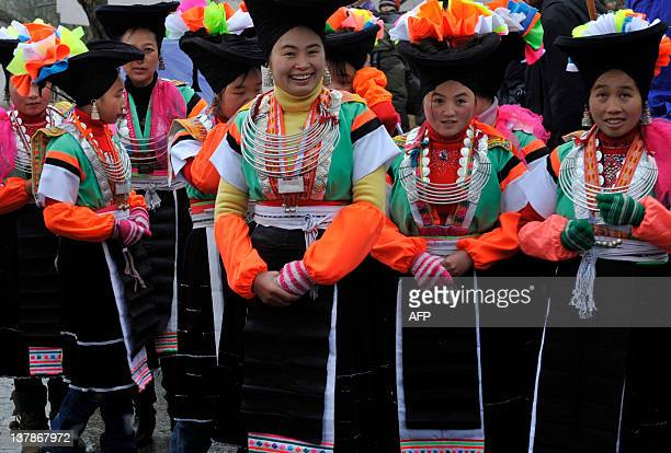 Miao tribal villagers welcome in the Year of the Dragon at a ceremony by offering their cattle in return for a good harvest in the new year in Longli...