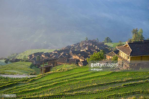 Miao village among rice terraces in sunrise light