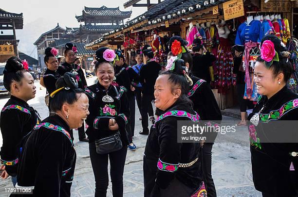 Miao women were talking and laughing in street of Xijing Miao village ,Guizhou province.