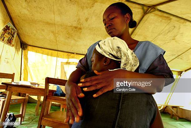 MONROVIA LIBERIA––Miatta Roberts a counselor with Concerned Christian Community consoles Rita who lives in distress since her 10–year–old daughter...