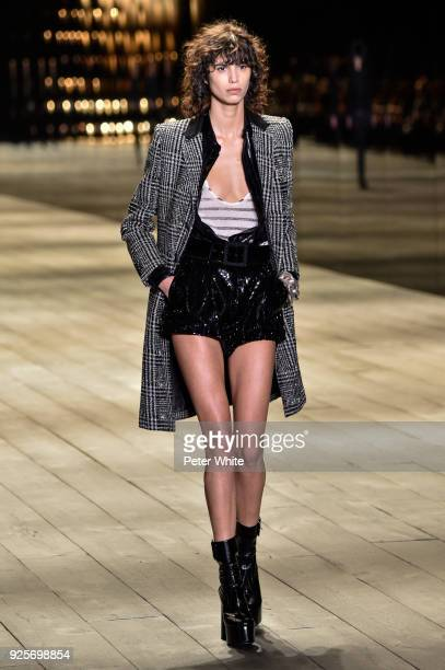 Mica Arganaraz walks the runway during the Saint Laurent show as part of the Paris Fashion Week Womenswear Fall/Winter 2018/2019 on February 27 2018...