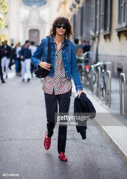 Mica Arganaraz wearing denim jacket Adidas sweat pant is seen outside Bottega Veneta during Milan Fashion Week Spring/Summer 2018 on September 23...