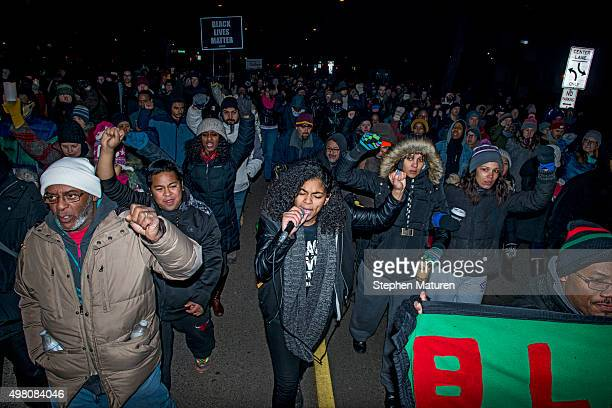 Mica Grimm center a member of Black Lives Matter leads a march from a makeshift memorial for Jamar Clark on the side of Plymouth Avenue several...