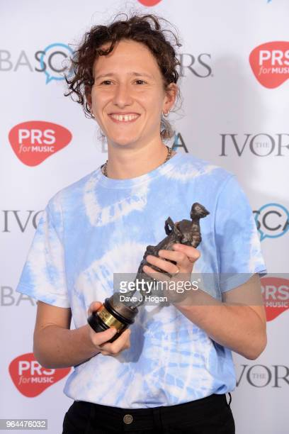 Mica Levi with the award for Best Original Film Score poses in the winner's room during the Ivor Novello Awards 2018 at Grosvenor House on May 31...