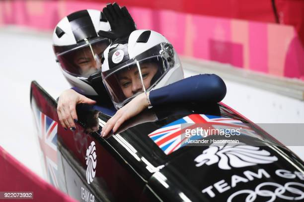 Mica Mcneill and Mica Moore of Great Britain react in the finish area during the Women's Bobsleigh heats on day twelve of the PyeongChang 2018 Winter...