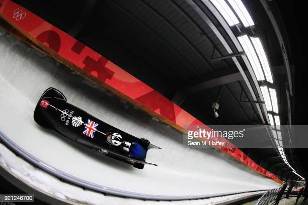 Mica McNeill and Mica Moore of Great Britain slide during the Women's Bobsleigh heats at the Olympic Sliding Centre on day eleven of the PyeongChang...