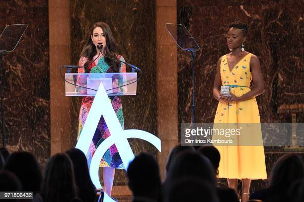 Micaela Erlanger accepts an award onstgae from Lupita Nyong'o during the 22nd Annual Accessories Council ACE Awards at Cipriani 42nd Street on June...