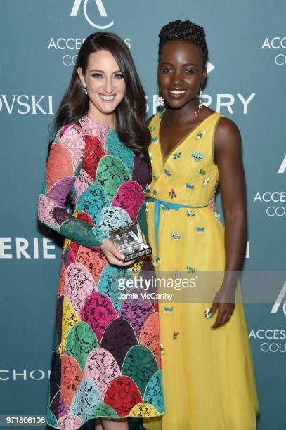 Micaela Erlanger and Lupita Nyong'o pose backstage at the 22nd Annual Accessories Council ACE Awards at Cipriani 42nd Street on June 11 2018 in New...