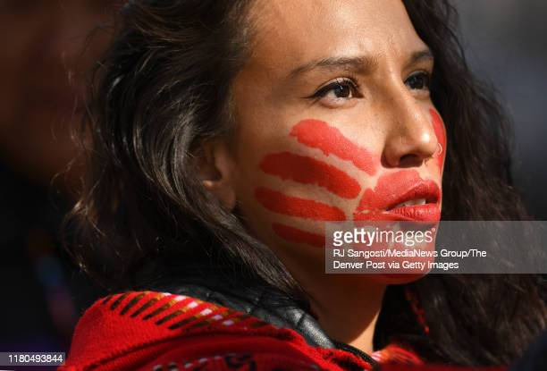 Micaela Iron Shell has painted red hands over their mouth to show solidarity for missing and murdered indigenous, black and migrant women and...