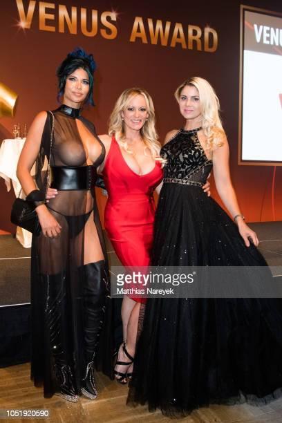 Micaela Schaefer Stormy Daniels and Yvonne Woelke attend the Venus Award during the Venus Erotic Fair 2018 at Hotel Ellington on October 11 2018 in...