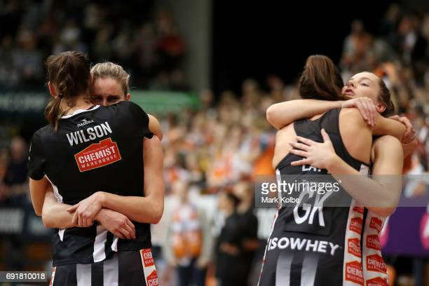 Micaela Wilson Shae Brown Sharni Layton and Alice TeagueNeeld of the Magpies comfort each other after defeat during the Super Netball Major Semi...