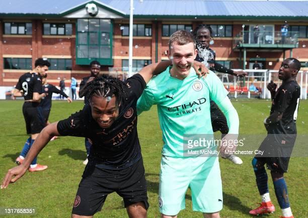 Micah Hamilton and Josh McNamara of Manchester City celebrate after winning the Under 18's Premier League North title during the Under 18's Premier...