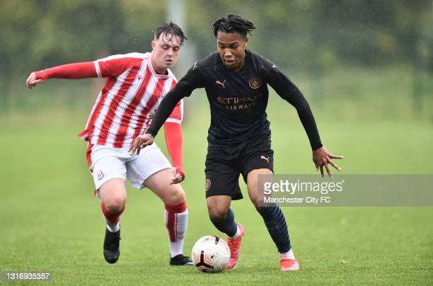 Micah Hamilton of Manchester City and Josh Ireland of Stoke City compete for the ball during the U18 Premier League match between Stoke City and...