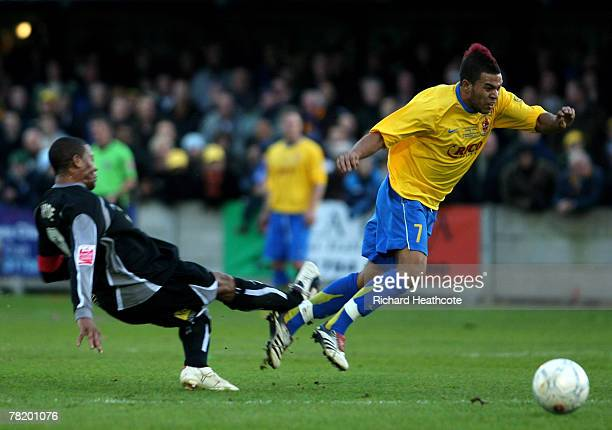 Micah Hyde of Peterborough tackles Lewis Cook of Staines during the FA Cup 2nd Round match between Staines Town and Peterborough United at Wheatsheaf...