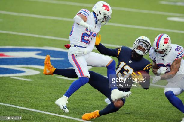 Micah Hyde of the Buffalo Bills steps into Keenan Allen of the Los Angeles Chargers during the third quarter at Bills Stadium on November 29, 2020 in...