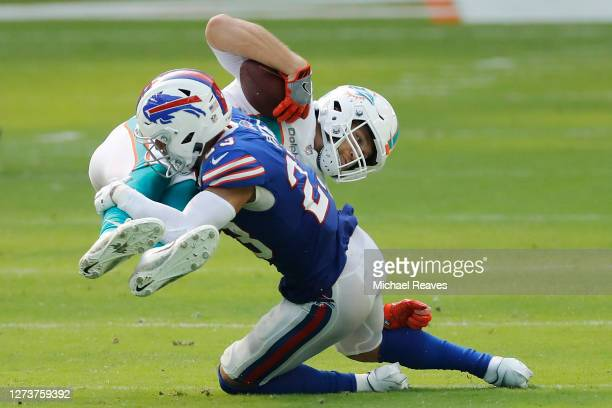 Micah Hyde of the Buffalo Bills tackles Mike Gesicki of the Miami Dolphins during the second half at Hard Rock Stadium on September 20, 2020 in Miami...
