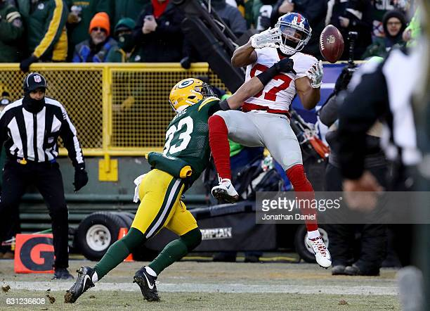 Micah Hyde of the Green Bay Packers breaks up a pass intended for Sterling Shepard of the New York Giants in the first quarter during the NFC Wild...